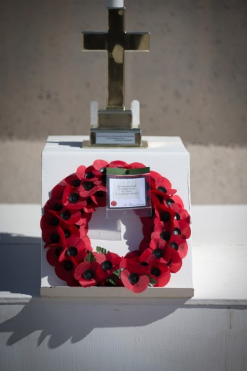 A wreath laid by Brigadier Rob Thomson is seen during a ceremony to mark Armistice Day attended by some of the British troops that still remain in Afghanistan at Kandahar airfield on November 11, 2014 in Kandahar, Afghanistan. (Matt Cardy/Getty Images)