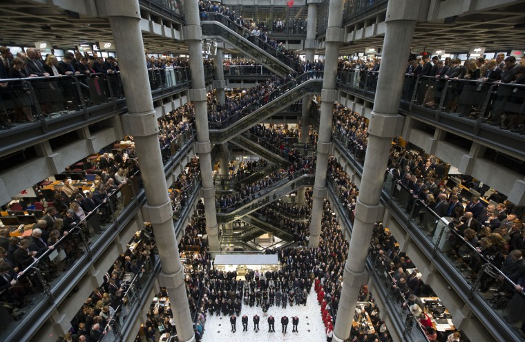 Poppies fall during a two-minute silence at a Remembrance Day service at the Lloyd's of London building on November 11, 2014 in London, United Kingdom. The annual Armistice Day service honours those who have lost their lives during times of war. This year, the 100th anniversary of the start of World War I, 5000 poppies were dropped along with the ringing of the Lutine Bell, the laying of wreaths before the Book of Remembrance and a two minute silence. (Carl Court/Getty Images)