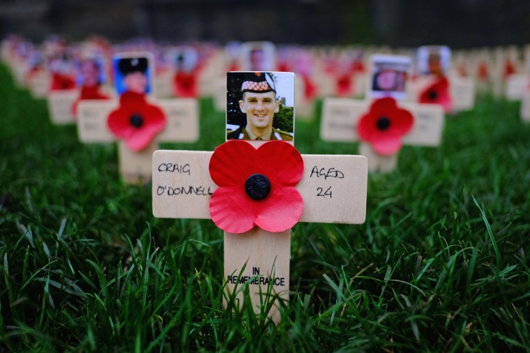 Crosses are placed in the garden of remembrance in Princess Street on Armistice Day, on November 11, 2014 in Edinburgh, Scotland. (Jeff J Mitchell/Getty Images)