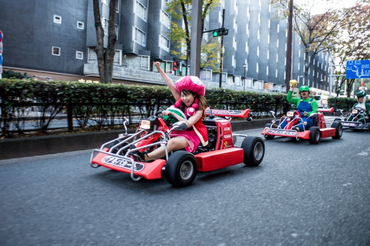 Participants drive around Tokyo for the Real Mario Kart event in Tokyo, Japan. The organizer calls for participants to this event held about once a month on Facebook, and Akiba Kart offers rental karts that can be driven on public streets. (Keith Tsuji/Getty Images)