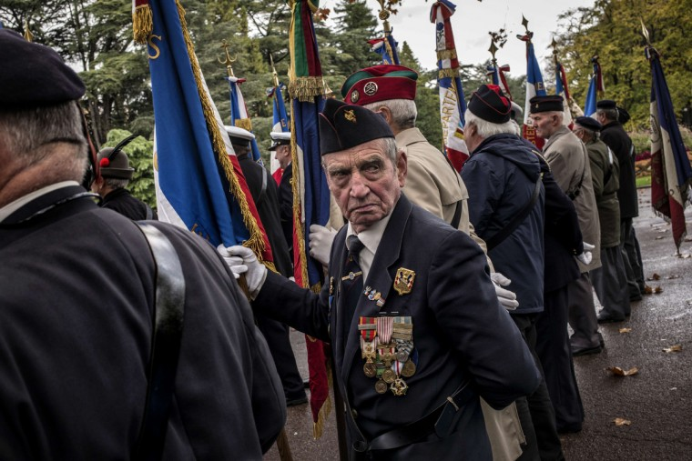 A French veteran holds a flag, on November 11, 2014 in Lyon, during the Armistice Day ceremonies marking the 96th anniversary of the end of World War I. AFP PHOTO / (Jeff Pachoud/AFP/Getty Images)