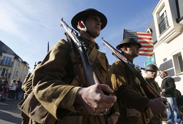 Performers wearing WWI US Army Sergeant's combat uniforms take part in a reenactment of WWI in Claye-Souilly, some 38 kilometers northeast of Paris, on November 11, 2014 as part of Armistice Day commemoration ceremonies marking the 96th anniversary of the end of World War I. (Francois Guillot/AFP/Getty Images)