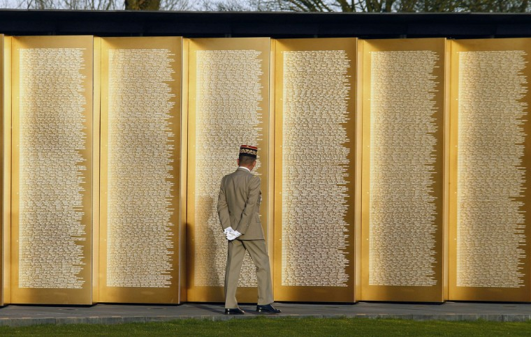 French President's chief-of-staff, General Benoit Puga, walks through the Notre-Dame de Lorette war memorial, listing the engraved names of 580,000 men who died in northern France during WWI, during a ceremony on November 11, 2014 in Ablain-Saint-Nazaire, northern France, part of the Armistice Day ceremonies marking the 96th anniversary of the end of World War I. (Michel Spingler/AFP/Getty Images)