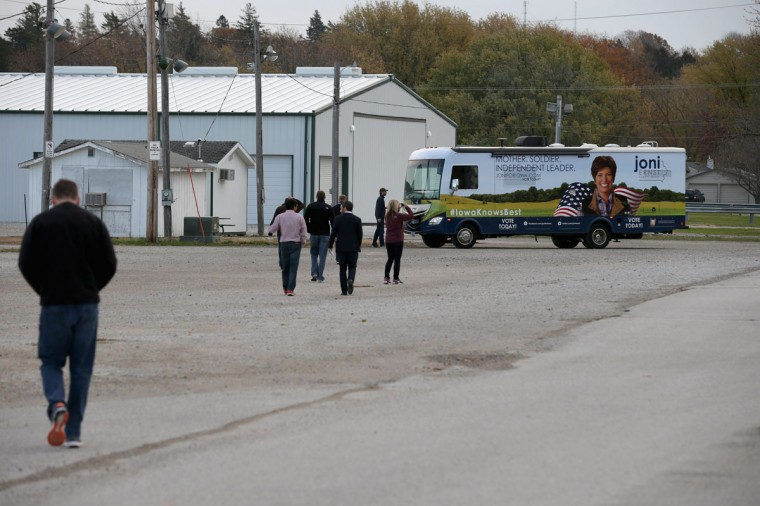 Campaign workers for Republican U.S. Senate candidate Joni Ernst walk back to her campaign RV after Ernst cast her ballot on election day in her hometown November 4, 2014 in Red Oak, Iowa. According to the polls, Ernst is in a neck-and-neck race with her opponent, Democratic candidate Rep. Bruce Braley (D-IA), and the election in Iowa could decide which party controls the U.S. Senate. (Chip Somodevilla/Getty Images)