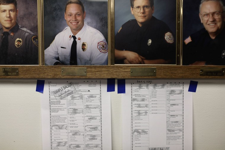 Sample ballots hang on the wall below photos of local firefighters at the Red Oak Fire Department November 4, 2014 in Red Oak, Iowa. According to the polls, Republican U.S. Senate candidate Joni Ernst is in a neck-and-neck race with Democratic candidate Rep. Bruce Braley (D-IA), and the election in Iowa could decide which party controls the U.S. Senate. (Chip Somodevilla/Getty Images)
