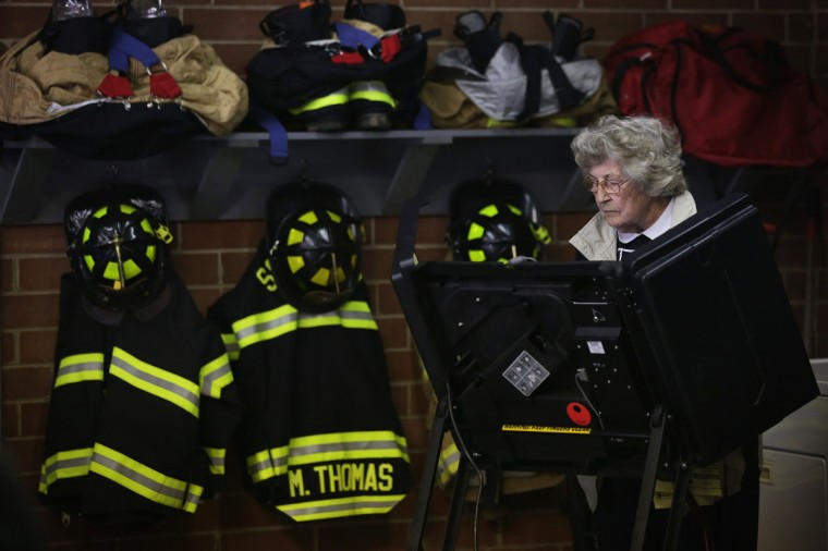 A voter casts her ballot at a fire station that serves as a polling place November 4, 2014 in Climax, North Carolina. U.S. Sen. Kay Hagan (D-NC) is running in a tight race against Republican opponent and Speaker of the North Carolina House of Representatives Thom Tillis for her seat in the U.S. Senate. (Alex Wong/Getty Images)