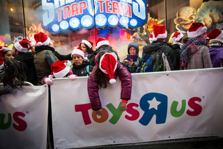 People wait in line to shop at the Toys R Us in Times Square on November 27, 2014 in New York, United States. Black Friday sales, which now begin on the Thursday of Thanksgiving, continue to draw shoppers out for deals and sales. (Photo by Andrew Burton/Getty Images)