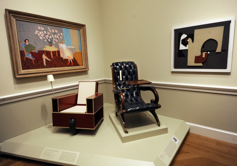 The Bookinist (Reading Chair) at left was designed in 2007 by Nils Holger Moormann, and is made of foil-covered birch plywood, felt, rubber, aluminum and chinz. The Reading Chair at right, c.1835, is an imitation of the style of chair made  by Prussian architect Karl Friedrich Schinkel in the early decades of the nineteenth century. The chair is made of walnut and brass with leather upholstery. (Algerina Perna/Baltimore Sun)