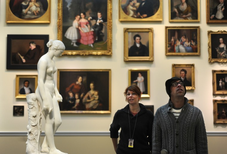 Suse Cairns, digital content manager for the BMA, and Ian Anderson, both from Baltimore, look at the artwork in the American wing. At left is the marble statue of Clytie, 1872 by William Henry Rinehart, who was born in Union Bridge, MD in 1825, and died in Rome in 1874. (Algerina Perna/Baltimore Sun)