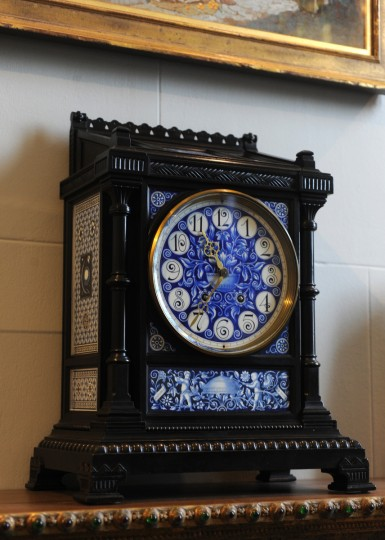 A mantel clock c. 1878 made of wood, porcelain, metal and glass by Lewis Foreman Day is on display in the Tiffany and Friends section of the American Wing. (Algerina Perna/Baltimore Sun)