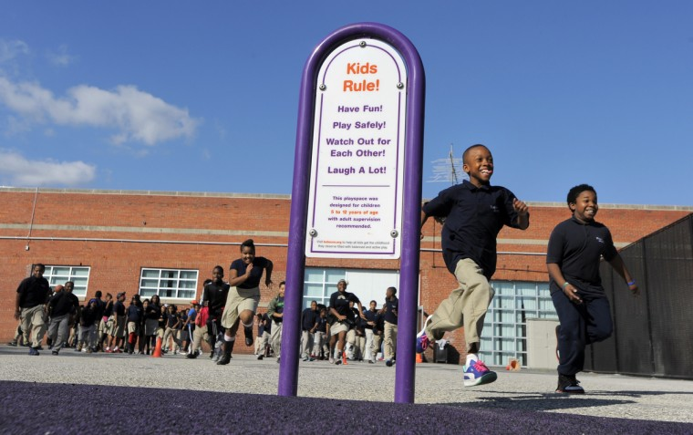 A newly constructed playground officially opened for the kids of the Monarch Academy Baltimore. More than 100 volunteers from Baltimore Gas and Electric Company, Monarch Academy Baltimore, The Children's Guild, organizers from KaBOOM! and residents of the Baltimore community joined forces to give area kids the childhood they deserve by building a new playground at Monarch Academy Baltimore. (Lloyd Fox/Baltimore Sun)