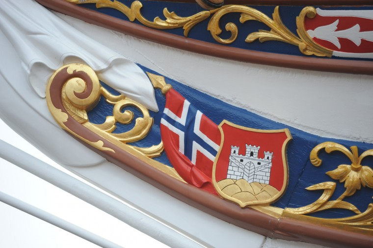 The national flag of Norway and the Bergen city seal adorn the bow of the HNoMS Statsraad Lehmkuhl, a training vessel for the Norwegian Navy. Kim Hairston/Baltimore Sun