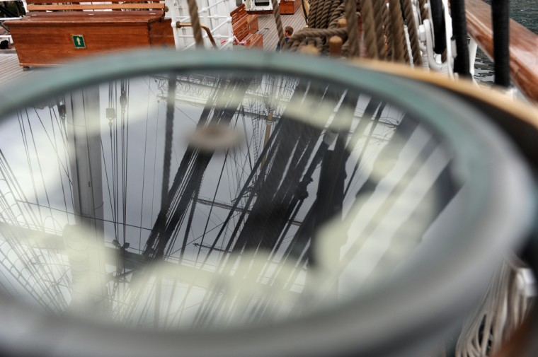 Rigging of the HNoMS Statsraad Lehmkuhl, a training vessel for the Norwegian Navy, is reflected on the glass of a compass. Kim Hairston/Baltimore Sun
