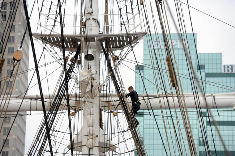A Merchant Navy cadet on the HNoMS Statsraad Lehmkuhl, a training vessel for the Norwegian Navy, climbs the shrouds. Sail Baltimore hosts the 100 year old 3-masted barque, the oldest and largest square rigged sailing vessel in Norway. It is docked at the Inner Harbor's West Wall. Kim Hairston/Baltimore Sun