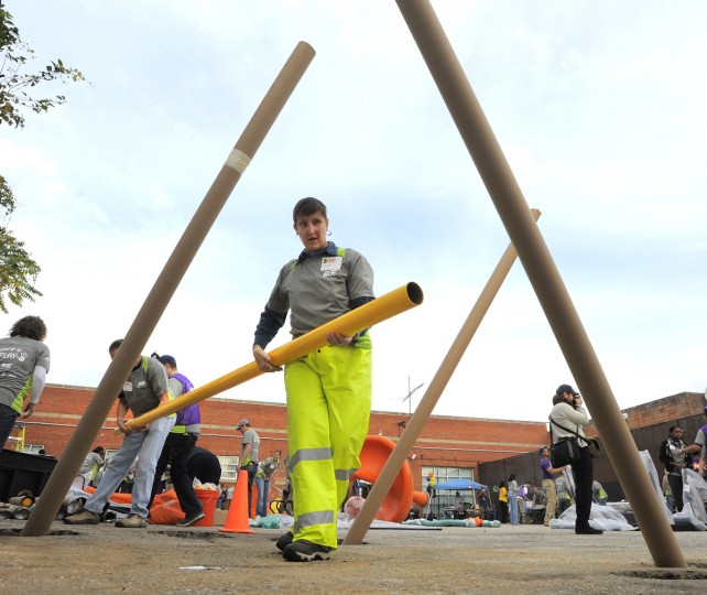 Theresa Marshall a volunteer helps with the playground construction. (Lloyd Fox/Baltimore Sun)
