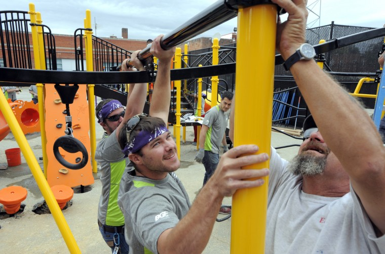 More than 100 volunteers from the Baltimore area to give kids the childhood they deserve by building a new playground at Monarch Academy. The design is based on children's drawings created at a special design event in September. (Lloyd Fox/Baltimore Sun)