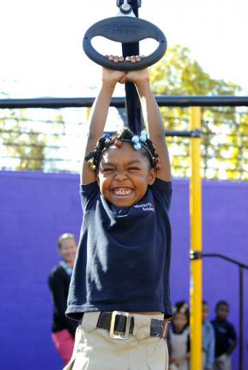 Madison Stinson enjoys the Zipline on the playground.  She is in first grade. (Lloyd Fox/Baltimore Sun)