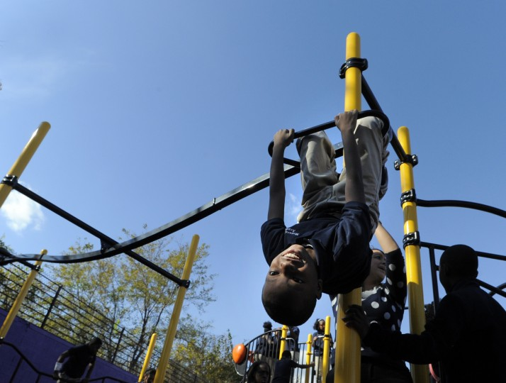 Newly constructed playground officially opened for the kids of the Monarch Academy in Baltimore. (Lloyd Fox/Baltimore Sun)