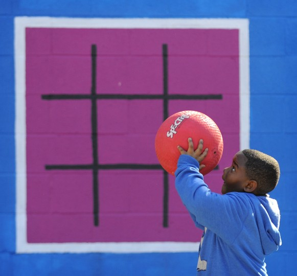 A newly constructed playground officially opened for the kids of the Monarch Academy Baltimore.  (Lloyd Fox/Baltimore Sun)
