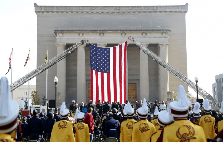 Veterans, public officials, families, schools, and other members of the community gather for a Veterans Day ceremony at Memorial Plaza in Baltimore, MD. (Cassidy Johnson/Baltimore Sun)