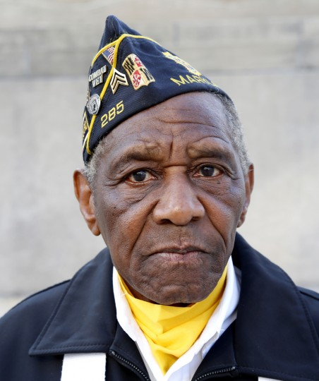 Milton England of the American Legion Post 285 Color Guard waits after marching during the Veterans Day parade in Baltimore, MD on Tuesday. England, 86, is a Navy World War II veteran. (Cassidy Johnson/Baltimore Sun)