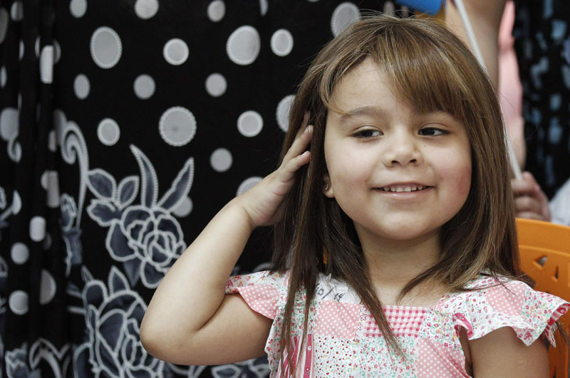 Cancer-stricken children find confidence with donated wigs