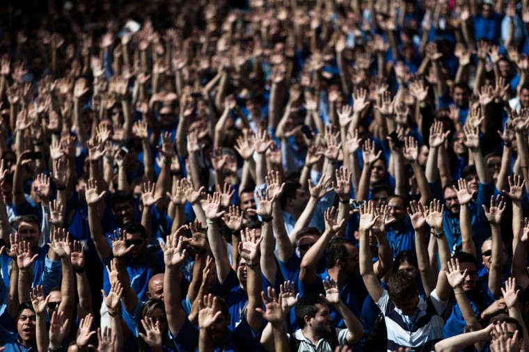 Employees of Embraer's main aircraft factory vote to end their strike for pay increases, in Sao Jose dos Campos, November 10, 2014. Embraer, the world's third largest commercial airplane manufacturer, said their operations were returning to normal after the five-day strike for higher wages was called off. (Roosevelt Cassio/Reuters)