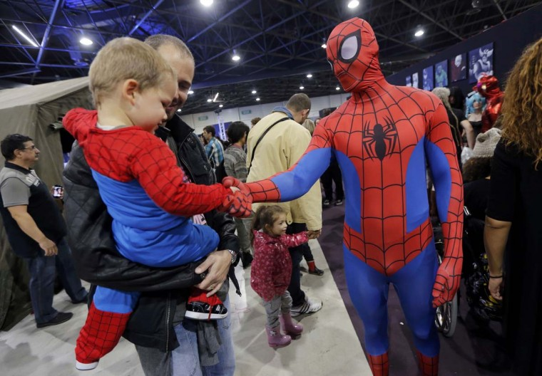 A participant dressed as superhero Spiderman greets a young fan during the first edition of the HeroFestival in Marseille, November 9, 2014. The festival is dedicated to American superhero comics, Japanese mangas , Heroic Fantasy characters and video games universes. Picture taken on November 9, 2014 (Jean-Paul Pelissier/Reuters)