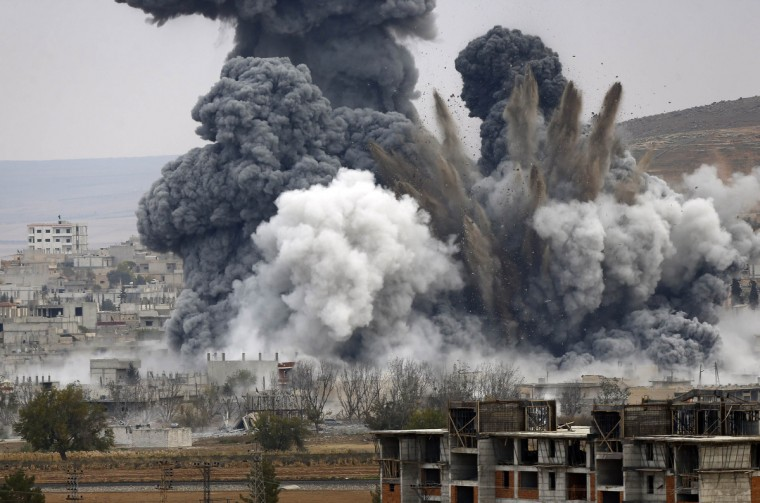 An explosion following an air strike is seen in central Kobani in Syria. Picture taken from the Turkish side of the Turkish-Syrian border. (Osman Orsal/Reuters)