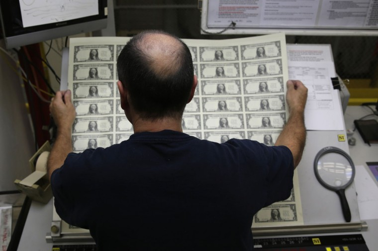 United States one dollar bills are inspected during production at the Bureau of Engraving and Printing in Washington November 14, 2014. (Gary Cameron/Reuters)