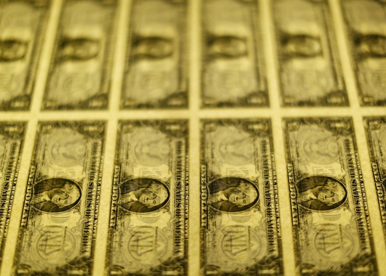 United States one dollar bills are seen on a light table at the Bureau of Engraving and Printing in Washington November 14, 2014. (Gary Cameron/Reuters)