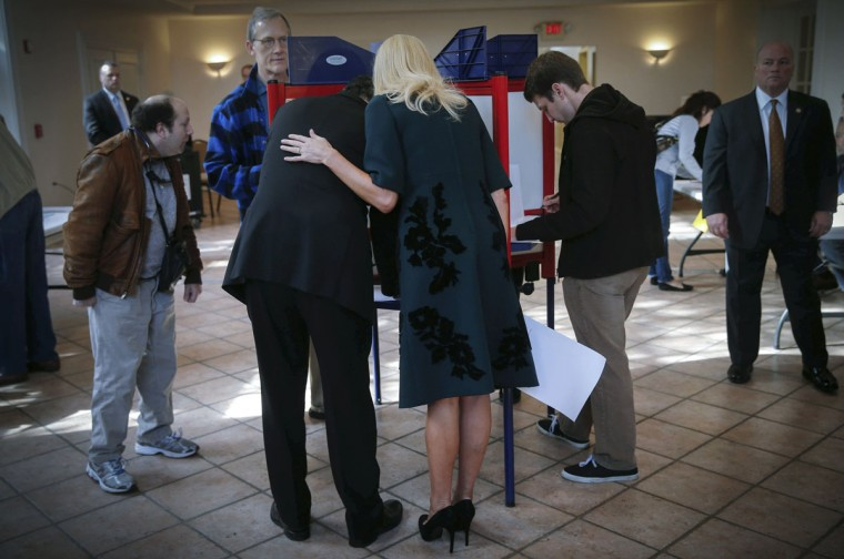 Democratic New York Governor Andrew Cuomo fills out his ballot as his girlfriend Sandra Lee looks on, at the Presbyterian Church in the town of Mount Kisco, New York, November 4, 2014. Cuomo is running for a second term as Governor of New York as Americans went to the polls Tuesday in the midterm elections. (Mike Segar/Reuters)