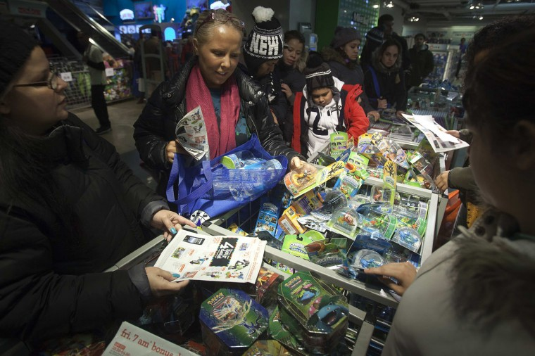 People shop for Skylander toys at Toys R Us in Times Square in New York November 27, 2014. Toys R Us opened on Thanksgiving evening at 5pm, ahead of many other Black Friday retailers. (Carlo Allegri/Reuters)