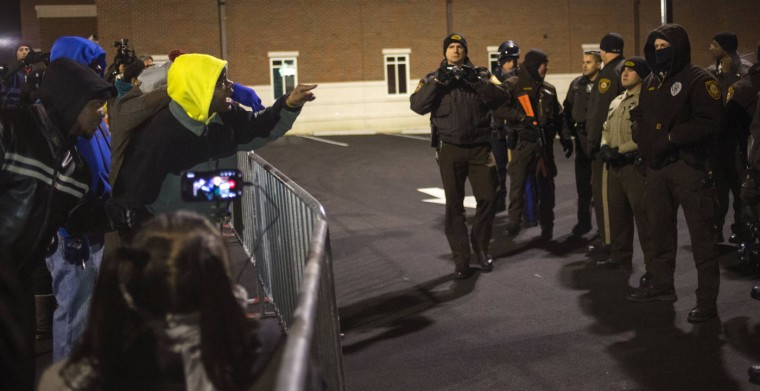 Protesters shout towards police as they demand the criminal indictment of a white police officer who shot dead an unarmed black teenager in August, outside the Ferguson Police Station in Missouri November 20, 2014. The St. Louis suburb of Ferguson has been bracing for months to learn whether a St. Louis County grand jury will charge police officer Darren Wilson in the slaying of 18-year-old Michael Brown, a case that has become a flashpoint for often-troubled U.S. race relations. (Adrees Latif/Reuters)