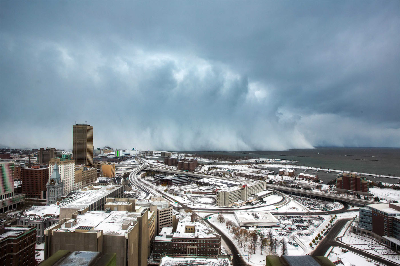 storm clouds and snow blows off lake erie in buffalo  new york