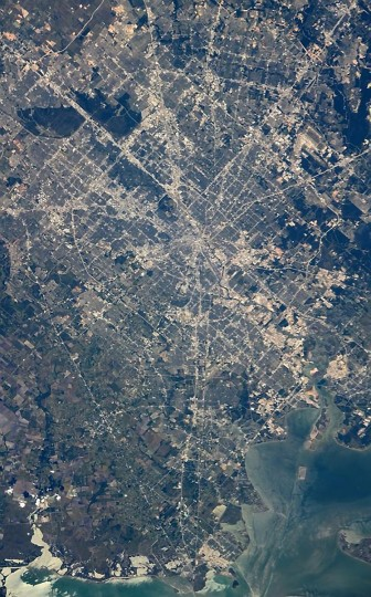 Wiseman said he was loving the new 50-500mm lens which he used to take this picture of Houston in the afternoon of October 26. (Reid Wiseman/NASA)