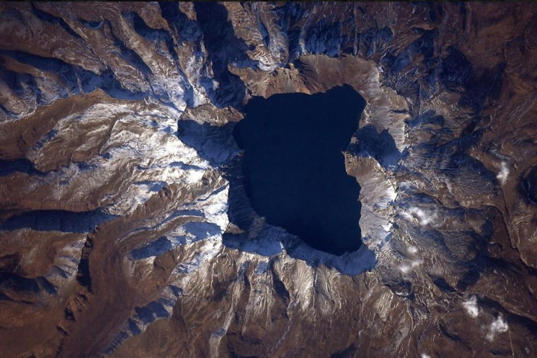 By luck, Wiseman spotted this breathtaking volcano as the space station flew over China. (Reid Wiseman/NASA)