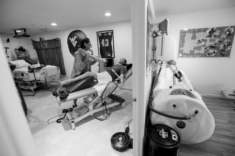Ken puts in around eight hours of physical therapy time per day with Ryan. Each limb is stretched, leaving no muscle unturned. (Kaitlin Newman/For The Baltimore Sun)