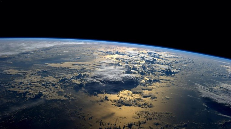 "NASA astronaut Reid Wiseman tweeted this photo from the International Space Station Sept. 2, 2014. ""My favorite views from space – just past sunrise over the ocean,"" the Expedition 40 astronaut tweeted. (Reid Wiseman/NASA)"