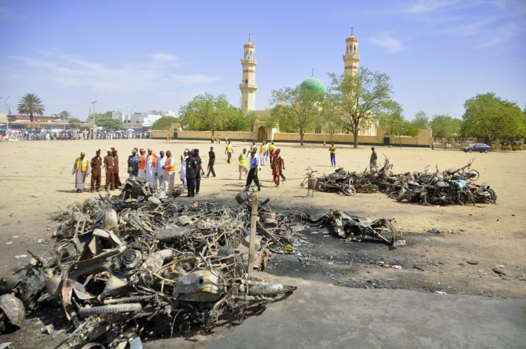 Security and emergency agency staff investigate the Kano Central Mosque bombing scene in Kano. Gunmen set off three bombs and opened fire on worshippers at the main mosque in north Nigeria's biggest city Kano on Friday, killing at least 81 people, witnesses and officials said, in an attack that bore the hallmarks of Islamist Boko Haram militants. (Stringer/Reuters)