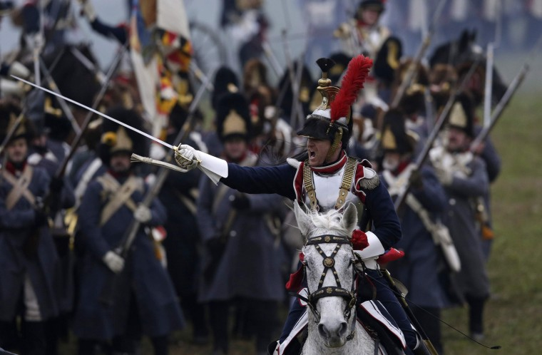 History enthusiasts dressed as soldiers fight during the re-enactment of Napoleon's famous battle of Austerlitz near the southern Moravian town of Slavkov u Brna. Hundreds of history enthusiasts took part in the re-enactment of the battle to mark its 209th anniversary. (David W Cerny/Reuters)