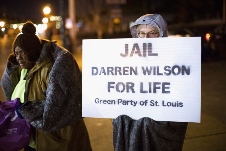 Demonstrators protest the shooting death of 18-year-old Michael Brown across from the police station on November 17, 2014 in Ferguson, Missouri. Brown was killed by Darren Wilson, a Ferguson police officer, on August 9. A grand jury is expected to decide this month if Wilson should be charged in the shooting. (Photo by Scott Olson/Getty Images)