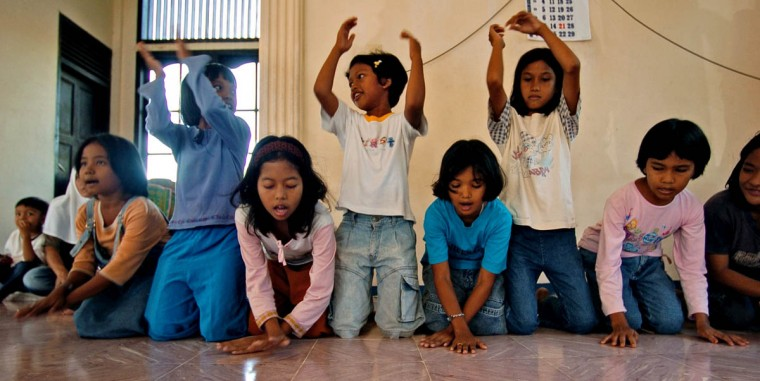 Young girls clap hands and chant to the delight of other youngsters at Camp MNS Desa Lamgugop Monday, Jan. 17 2005. Save The Children has begun sponsoring safe spaces for the children, who have been victimized by a tsunami that swept through the town in December. (Karl Merton Ferron, Baltimore Sun)