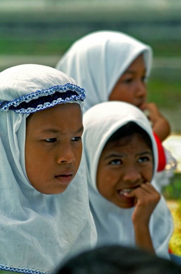 Humaira, 11 stares blankly as other children react to their instructor January 14, 2005 after a tsunami destroyed their home and disrupted their lives in December. (Karl Merton Ferron, Baltimore Sun)