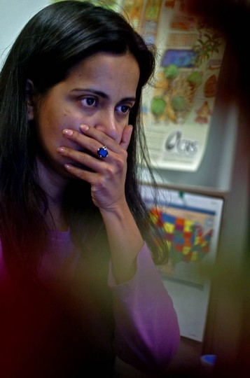 The stress of having to coordinate information of a massive amount of relief effort for an upcoming meeting shows on the face of Chadreyee Banerjee of Catholic Relief Services. (Karl Merton Ferron, Baltimore Sun)