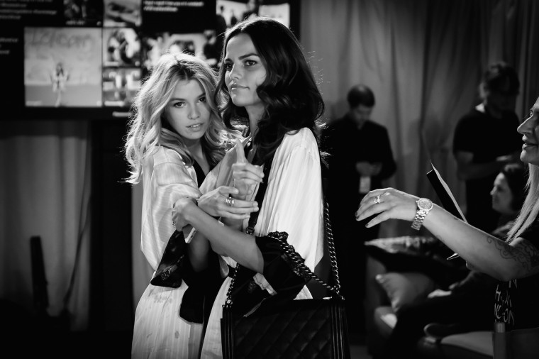 Victoria's Secret model Stella Maxwell (L) and Adriana Lima backstage prior to the 2014 Victoria's Secret Fashion Show on December 2, 2014 in London, England.  (Gareth Cattermole/Getty Images for Victoria's Secret)