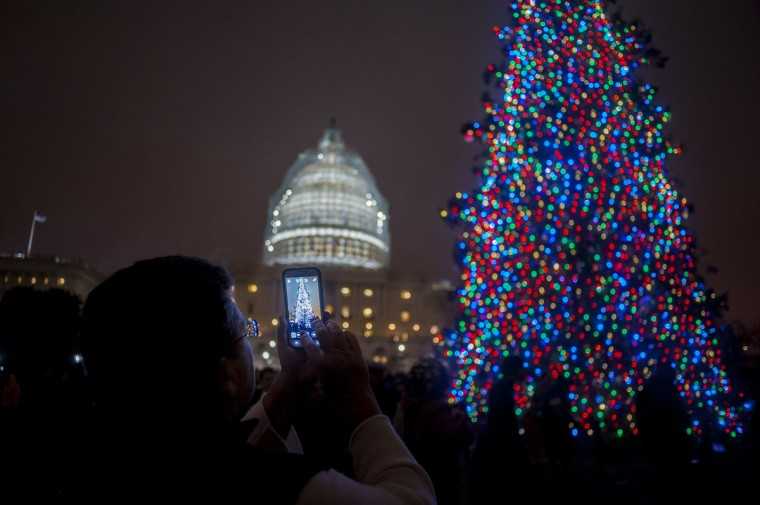 Speaker of the House, John Boehner (R-OH), assisted by Aaron Urban, 10, of Linthicum, MD, threw the switch to light the Capitol Christmas Tree in front of the U.S. Capitol on December 2, 2014 in Washington, DC. Urban, who is fighting brain cancer, is helping light the tree as the kickoff for his one-true-wish, being granted by Make-A-Wish Mid-Atlantic, to spend Christmas in New York City. The tree is an 88-foot white spruce from the Chippewea National Forest in Cass Lake, Minnesota. (Pete Marovich/Getty Images)