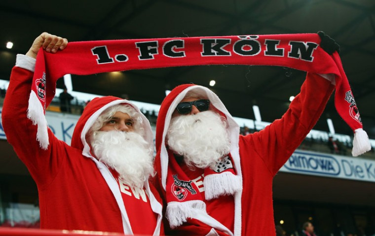 Two fans of Koeln wear Santa Claus dresses during the Bundesliga match between 1. FC Koeln and FC Augsburg at RheinEnergieStadion on December 6, 2014 in Cologne, Germany. (Alex Grimm/Bongarts/Getty Images)