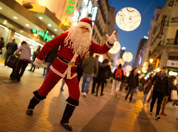 A man dressed as Santa Claus poses for a photograph in Calle Preciados on December 19, 2014 in Madrid, Spain. Shoppers took to the streets in the Spanish capital ahead of the annual Christmas festivities. (Denis Doyle/Getty Images)