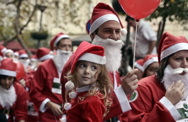Runners wearing Santa Claus costumes take part in the first Athens 'Santa Claus Run' in city's center on December 7, 2014. (Louisa Gouliamaki/AFP/Getty Images)